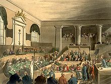 a painting of a large, pillared white room filled with people in the middle of a court case. The view is from the side; an advocate can be seen in a box on the right, while on the left are a panel of judges sitting in front of a curved desk.