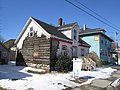 Old House in Charlottetown, PEI with exposed logs (39230843190).jpg