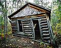 Old building at Conrad, Yukon (10752649206).jpg