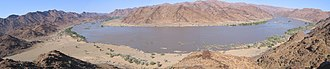Orange River - Panorama taken from a fluorspar-rich hill overlooking a bend in the River, which was in flood due to above-normal rains.