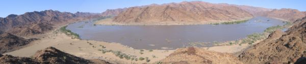 Panorama taken from a fluorspar-rich hill overlooking a bend in the River, which was in flood due to above-normal rains.