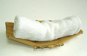 Oshibori - Oshibori presented on a small bamboo stand
