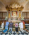 Our Lady of the Gate of Dawn Interior With Worshippers, Vilnius, Lithuania - Diliff.jpg