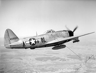 Fighter-bomber - Republic P-47D with fragmentation bombs on the wing and a belly tank, 1945