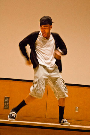 Dougie - University student performs the Dougie during a talent show.