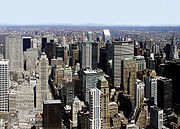 Modern global cities, like New York City, often include large central business districts that serve as hubs for economic activity.