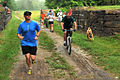 Participants run during the 12th Annual Tom's Run, beside the chesapeake and ohio canal.jpg