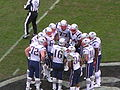 Patriots in huddle at New England at Oakland 12-14-08.JPG