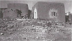 Photo from the Arab village of Lajjun, 1924. Columns street half-buried and surrounded by the huts (Rockefeller Museum).jpg
