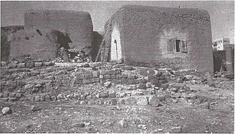 Lajjun - Image: Photo from the Arab village of Lajjun, 1924. Columns street half buried and surrounded by the huts (Rockefeller Museum)