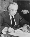 Photograph of President Franklin D. Roosevelt Signing the Declaration of War Against Japan, 12-08-1941 - NARA - 520053.tif