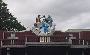 Our Lady of Piat - The candle area beside the shrine depicting the Coronation of the Virgin.