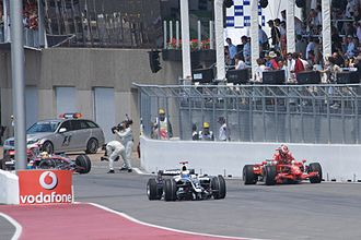 2008 Canadian Grand Prix - In the aftermath of the collision, Kimi Räikkönen and Hamilton retired from the race, whilst Nico Rosberg continued with a broken front wing.