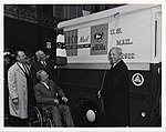 Postmaster General J. Edward Day pulls the drapes displaying the ABCD poster on the special vehicle used for the collection of the Accelerated Business Collection Delivery mail (13911295103).jpg