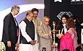 Pranab Mukherjee lighting the lamp to inaugurate the Diamond Jubilee Celebration of the Kishinchand Chellaram College, Mumbai. The Governor of Maharashtra, Shri K. Sankaranarayanan and the Chief Minister of Maharashtra.jpg
