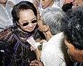 President Gloria Macapagal-Arroyo receives a warm kiss from an elderly woman.jpg