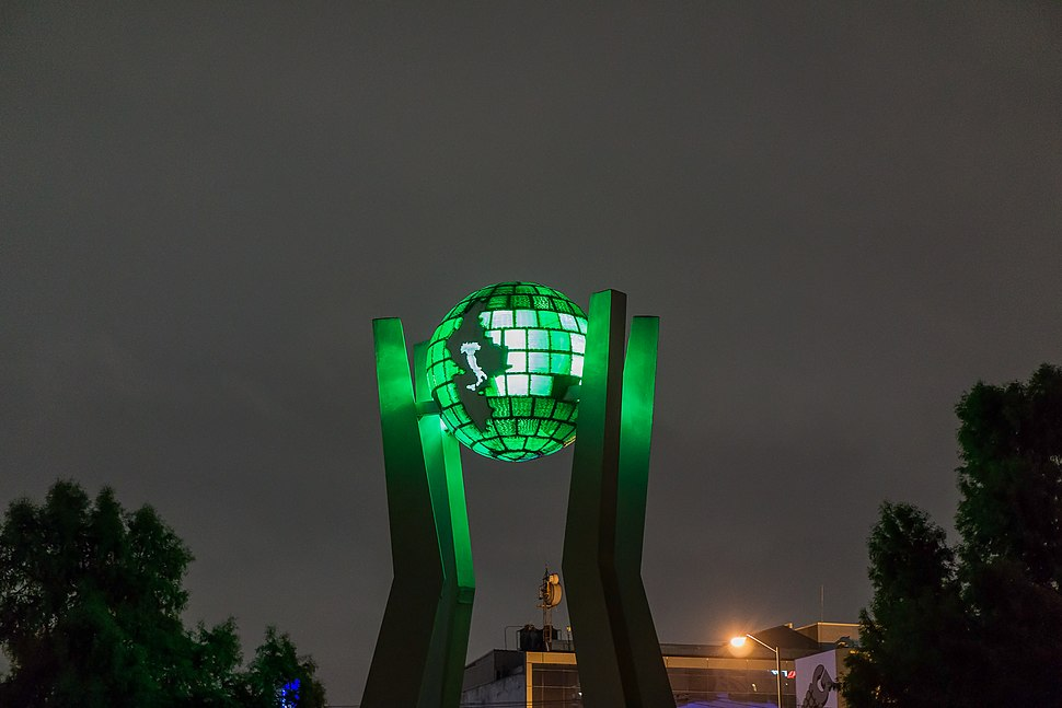Green outdoor monument of Italy on a globe