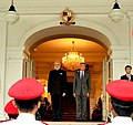 Prime Minister Narendra Modi inspects a guard of honour at the ceremonial welcome in Istana, Singapore.jpg