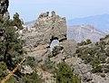 Red Rock escarpment natural arch.jpg