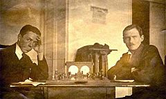 https://upload.wikimedia.org/wikipedia/commons/thumb/f/f3/Romanovsky-Alekhine_(1920).jpg/240px-Romanovsky-Alekhine_(1920).jpg