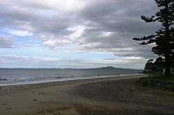 Rothesay Bay Beach with Rangitoto Island in the distance in the Hauraki Gulf