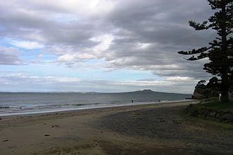 Rothesay Bay - Rothesay Bay Beach with Rangitoto Island in the distance in the Hauraki Gulf