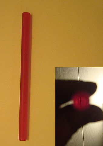 A ruby laser rod. Inset: The view through the rod is crystal clear Ruby laser rod and view through.JPG