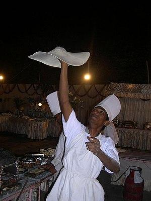 Rumali roti - A chef preparing rumali roti.