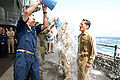 SS Ronald Reagan (CVN 76) Buckets of Water spilled over sailors after promotion to Capt. and Lt. Cmdr. - 080901-N-4995K-045.jpg