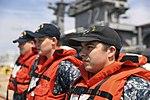 Sailors prepare to handle mooring lines from USS Harry S. Truman. (36009630702).jpg
