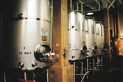 Fermenting tanks with yeast being used to brew beer.