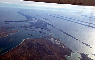 Peneplain - Aerial view of the almost flat and drowned peneplain at Belcher Islands, Hudson Bay, Canada. Note that the peneplain cuts across numerous folds.