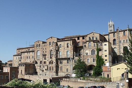 Siena's Santa Maria della Scala Hospital, one of Europe's oldest hospitals. During the Middle Ages, the Catholic Church established universities to revive the study of sciences, drawing on the learning of Greek and Arab physicians in the study of medicine. SantaMariaDellaScalaSienaBack.JPG