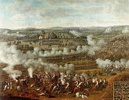 Paitning of armies in formation exchanging musket fire across a hilly landscape.