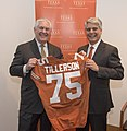 Secretary Tillerson Holds up a Jersey Dedication to him at the University of Texas Austin (39132322715).jpg