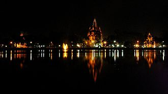 Sivasagar Sivadol - Night view of the Sivasagar lake with the three temples of Sivadol (highest temple in India in the middle), Vishnudol and Devidol, on its bank