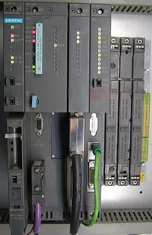 Industrial control system - Siemens Simatic S7-400 system in a rack, left-to-right: power supply unit (PSU), CPU, interface module (IM) and communication processor (CP).