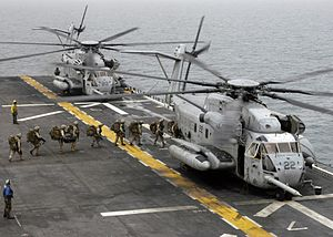 Operation Eastern Exit - Marines board two CH-53E Super Stallion helicopters (with refueling probes attached) on USS ''Bataan'', a ship similar to Guam