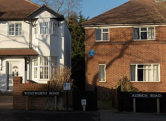 Cutteslowe - Wentworth Road joins Aldrich Road. An Oxfordshire blue plaque notes the site of the former Cutteslowe Walls.