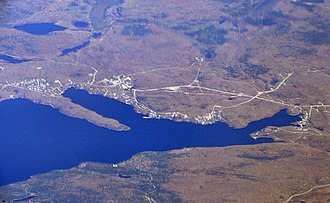 Nickel Centre - Aerial view of Skead (top) with Boland's Bay at right