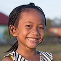 Smiling young girl with deciduous teeth.jpg