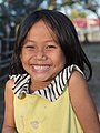 Smiling young girl with yellow shirt.jpg