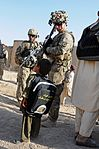 Soldier interacts with Afghan boy after Zharay district school open house DVIDS489696.jpg