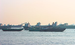 Some barges and fishing trawlers are wating near the Patenga Sea Beach.jpg
