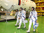 Soyuz TMA-05M crew during the 'fit check'.jpg