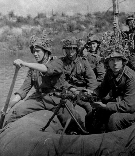 Blue Division members on a raft somewhere close to Leningrad Spanish soldiers on a raft during the Eastern Front scenario of World War II.jpg