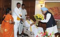 Sr. Leader of Tamil Nadu, Shri M. Karunanidhi and Shri T.R. Baalu (M.P.), meeting the Prime Minister, Dr. Manmohan Singh, in New Delhi on October 22, 2011.jpg