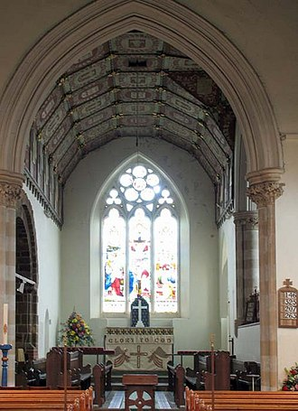 Chancel - A medium-sized English church showing the nave, chancel arch, and a chancel with choir and sanctuary