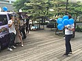 Staff Photographing Player with Female Promotional Model 20160430a.jpg