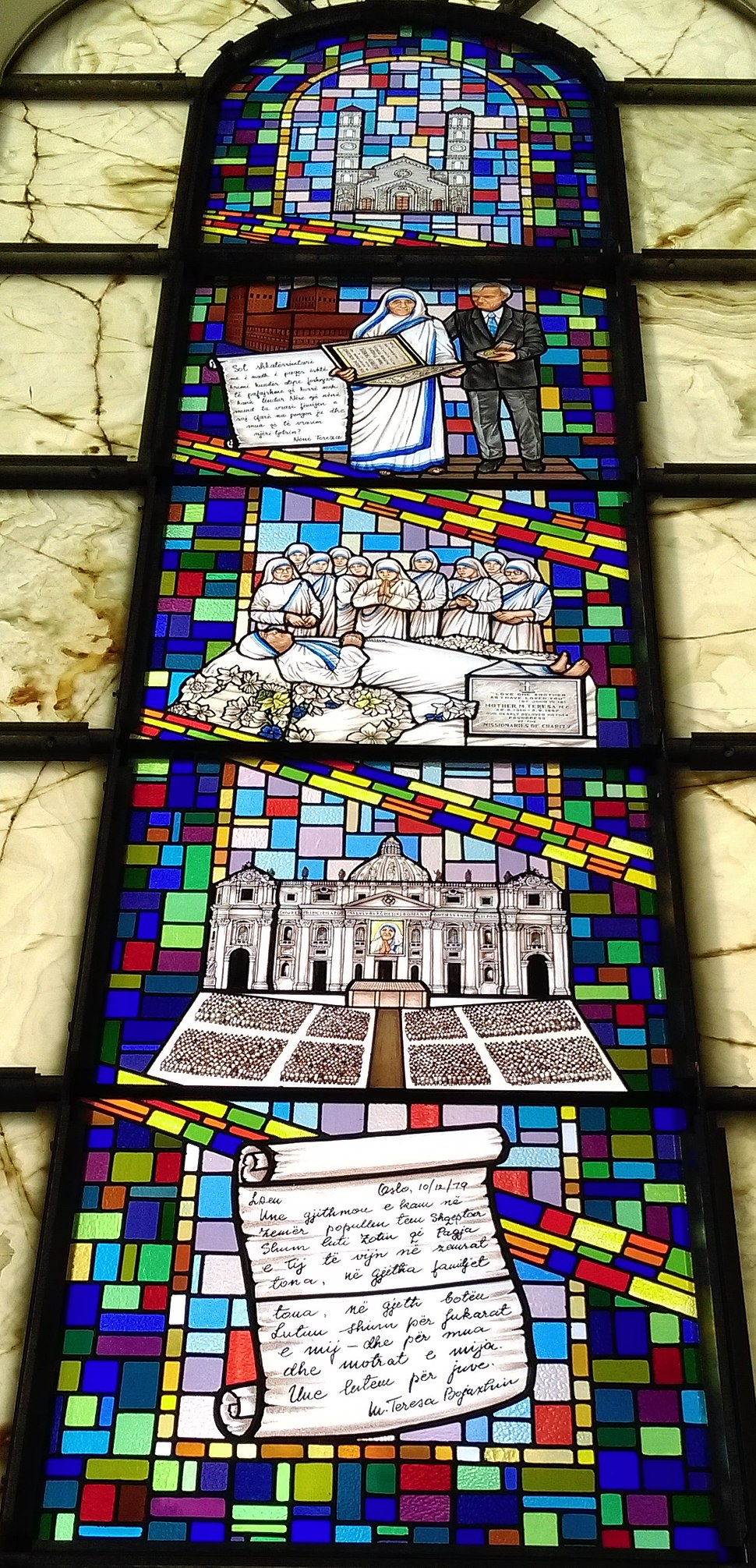 Stained glass depiction of key moments in the lifetime of Mother Teresa at the Cathedral of Saint Mother Teresa in Prishtina